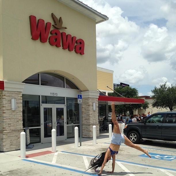 #kadria going woowoo at the @wawa! #tampa #florida #cartwheel #wawaismetal #tourlife #bikinitop #daisydukes #ladyk #wawarocks