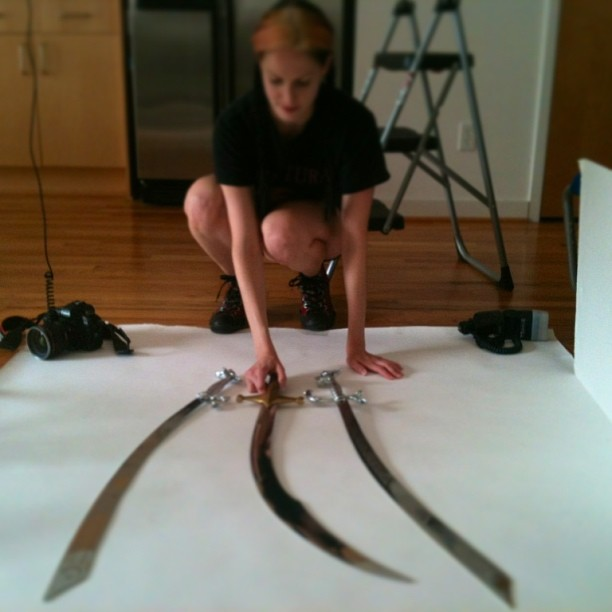 What is Emily Harris doing with #Kadria 's blades? We'll find out in a few months! #scimitars #photographer #artifacts #swords #stickemwiththepointyend