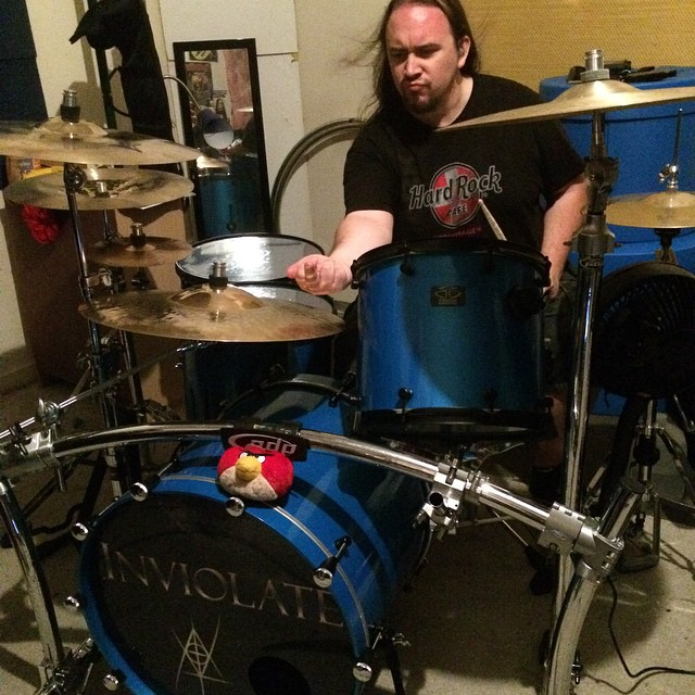 #2pt0 #drummer @erniehw working hard on our set while the resident #AngryBird eyes him from the kick drum. #TrickDrums #nofilter #metalface #beatmaster
